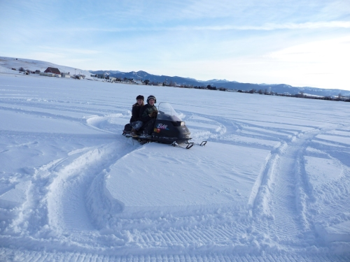 Having too much fun on my FIL's new snow mobile