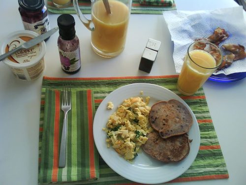 Berry/banana whole wheat pancakes, scrambled eggs, and bacon (for those who like it).